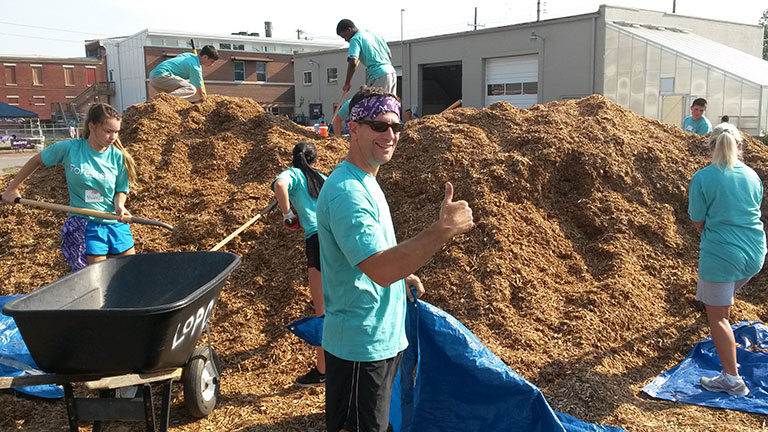 Codigo employees volunteering to build a playground for the community